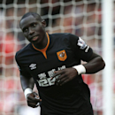 Hull City's Mohamed Diame celebrates after scoring his sides first goal of the game during the Premier League soccer match between Arsenal and Hull City at the Emirates stadium in London Saturday, Oct. 18, 2014