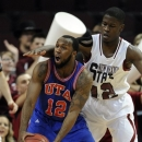 UT Arlington's Shaquille White-Miller (12) looks to pass against New Mexico State's K.C. Ross-Miller (12) during the first half of a Western Athletic Conference tournament championship NCAA college basketball game, Saturday, March 16, 2013 in Las Vegas. (AP Photo/David Becker)