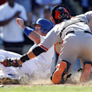 San Francisco Giants catcher Buster Posey, right, tags out Los Angeles Dodgers' A.J. Ellis, left, trying to score from second base on a single to end the seventh inning in a baseball game on Saturday, April 5, 2014, in Los Angeles The Associated Press
