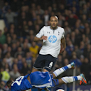 Chelsea's Samuel Eto'o, below, falls in the penalty area by Tottenham Hotspur's Younes Kaboul, during their English Premier League soccer match, at the Stamford Bridge Stadium in London, Saturday, March 8, 2014