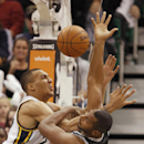 San Antonio Spurs' Boris Diaw, left, fights for a rebound with Utah Jazz's Rudy Gobert during the second half of an NBA basketball game in Salt Lake City, Friday, Nov. 15, 2013. The Spurs won 91-82. (AP photo/George Frey) The Associated Press