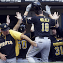 Pittsburgh Pirates Neil Walker (18) is congratulated after hitting a three-run home run during the seventh inning of a baseball game against the Milwaukee Brewers Monday, Sept. 2, 2013, in Milwaukee. (AP Photo/Morry Gash)