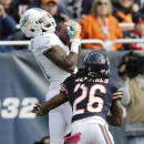 Miami Dolphins running back Lamar Miller (26) makes a touchdown reception against Chicago Bears cornerback Tim Jennings (26) during the first half of an NFL football game Sunday, Oct. 19, 2014 in Chicago The Associated Press