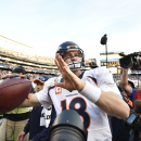 Denver Broncos quarterback Peyton Manning (18) prepares to throw a football into the crowd after an NFL football game against the San Diego Chargers, Sunday, Dec. 14, 2014, in San Diego The Associated Press