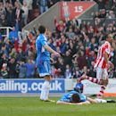 Stoke City's Peter Odemwingie, right, celebrates his goal against Hull City during their English Premier League soccer match at the Britannia Stadium, Stoke On Trent, England, Saturday, March 29, 2014