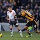 Hull City s Jake Livermore, right, and Liverpool s Phillippe Coutinho battle for the ball during the English Premier League soccer match at the KC Stadium, Hull, England, Sunday Dec. 1, 2013
