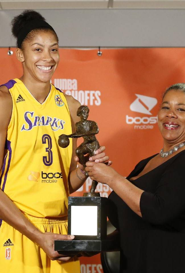 WNBA President Laurel J. Richie, right, presents Los Angeles Sparks forward Candace Parker, left, with the WNBA MVP award during a media availability before the Sparks play the Phoenix Mercury in the opener of their WNBA basketball Western Conference semifinal series on Thursday, Sept. 19, 2013, in Los Angeles