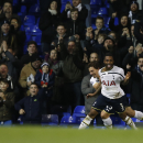 Tottenham's Danny Rose, no 3, celebrates after scoring his sides fourth goal during the English FA Cup third round replay soccer match between Tottenham Hotspur and Burnley at the White Hart Lane stadium in London, Wednesday, Jan. 14, 2015