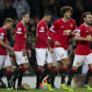 Manchester United's Marouane Fellaini, second right, celebrates with teammates after scoring during the English Premier League soccer match between Manchester United and Stoke City at Old Trafford Stadium, Manchester, England, Tuesday Dec. 2, 2014