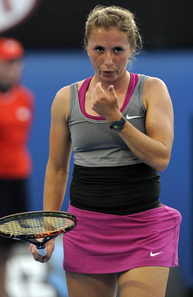 Annika Beck of Germany reacts between points as she plays Ana Ivanovic of Serbia during their second round match at the Australian Open tennis championship in Melbourne, Australia, Wednesday, Jan. 15, 2014