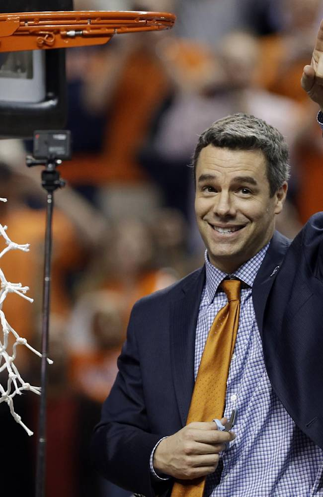In this March 16, 2014, file photo, Virginia coach Tony Bennett celebrates after Virginia defeated Duke in an NCAA college basketball game for the championship of the Atlantic Coast Conference men's tournament in Greensboro, N.C. Coming off the program's best season in decades, Virginia announced Tuesday, June 3, 2014, that Bennett has signed a new seven-year contract that will keep him courtside with the Cavaliers through the 2020-21 season