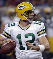 Green Bay Packers quarterback Aaron Rodgers throws during the first quarter of an NFL football game against the St. Louis Rams, Saturday, Aug. 17, 2013, in St. Louis. (AP Photo/Seth Perlman)