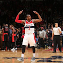 WASHINGTON, DC -  APRIL 24: John Wall #2 of the Washington Wizards celebrates a victory against the Toronto Raptors in Game Three of the Eastern Conference Quarterfinals during the 2015 NBA Playoffs on April 24, 2015 at Verizon Center in Washington, DC. (Photo by Ned Dishman/NBAE via Getty Images)