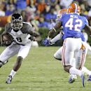 Missouri wide receiver Darius White (8) looks for a way around Florida defenders, including defensive back Keanu Neal (42), after a reception during the first half of an NCAA college football game in Gainesville, Fla., Saturday, Oct. 18, 2014 The Associat