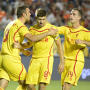 IMAGE DISTRIBUTED FOR GUINNESS INTERNATIONAL CHAMPIONS CUP - Liverpool's Steven Gerrard, center, celebrates with teammates, Rickie Lambert, left, and Jordan Henderson after he scored against Manchester United in the 2014 Guinness International Champions C