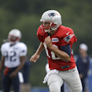 New England Patriots quarterback Tom Brady, right, advances down the field during an NFL football training camp practice at Gillette Stadium, Sunday, July 27, 2014, in Foxborough, Mass The Associated Press