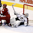 Phoenix Coyotes' David Moss (18) and Colorado Avalanche's Jan Hejda (8), of the Czech Republic, get up after both collide into Avalanche goalie Semyon Varlamov, of Russia, stays on the ice as a goal is disallowed during the third period of an NHL hockey g