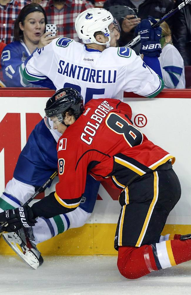 Santorelli scores in OT and Canucks top Flames 5-4