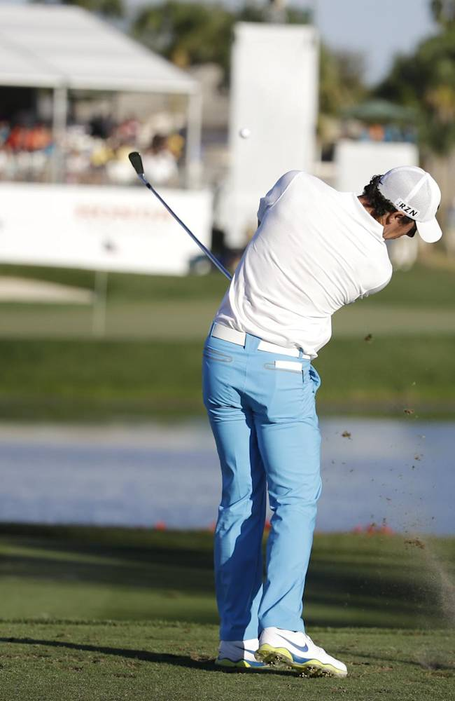Rory McIlroy of Northern Ireland hits his tee shot onto the 17th green during the third round of the Honda Classic golf tournament, Saturday, March 1, 2014, in Palm Beach Gardens, Fla