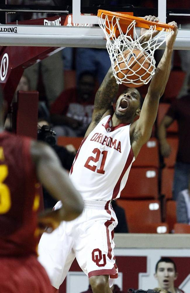 Oklahoma guard Cameron Clark dunks against Iowa State during the first half of an NCAA college basketball game in Norman, Okla. on Saturday, Jan. 11, 2014