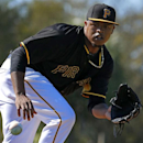 Pittsburgh Pirates pitcher Edinson Volquez fields a ball during a baseball spring training drill in Bradenton, Fla., Sunday, Feb. 16, 2014 The Associated Press