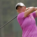 Stacy Lewis of the United States watches her shot on the 4th hole during the second round of the LPGA Malaysia golf tournament at Kuala Lumpur Golf and Country Club in Kuala Lumpur, Malaysia, Friday, Oct. 10, 2014. (AP Photo/Lai Seng Sin)