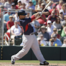 Boston Red Sox's Daniel Nava follows through with his swing on a home run hit off a pitch by Minnesota Twins' Scott Diamond in the first inning of an exhibition baseball game, Saturday, March 1, 2014, in Fort Myers, Fla The Associated Press