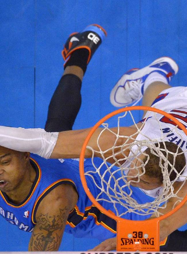 Oklahoma City Thunder forward Caron Butler, left, puts up a shot as Los Angeles Clippers forward Blake Griffin defends in the second half of Game 3 of the Western Conference semifinal NBA basketball playoff series, Friday, May 9, 2014, in Los Angeles. The Thunder won 118-112