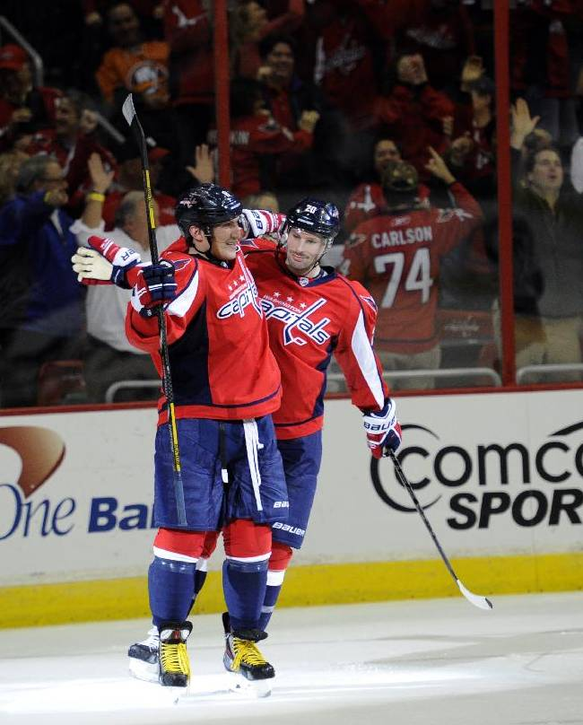 Washington Capitals right wing Alex Ovechkin, of Russia, left, celebrates his goal with Troy Brouwer, right, against the New York Islanders during the second period an NHL hockey game, Tuesday, Nov. 5, 2013, in Washington