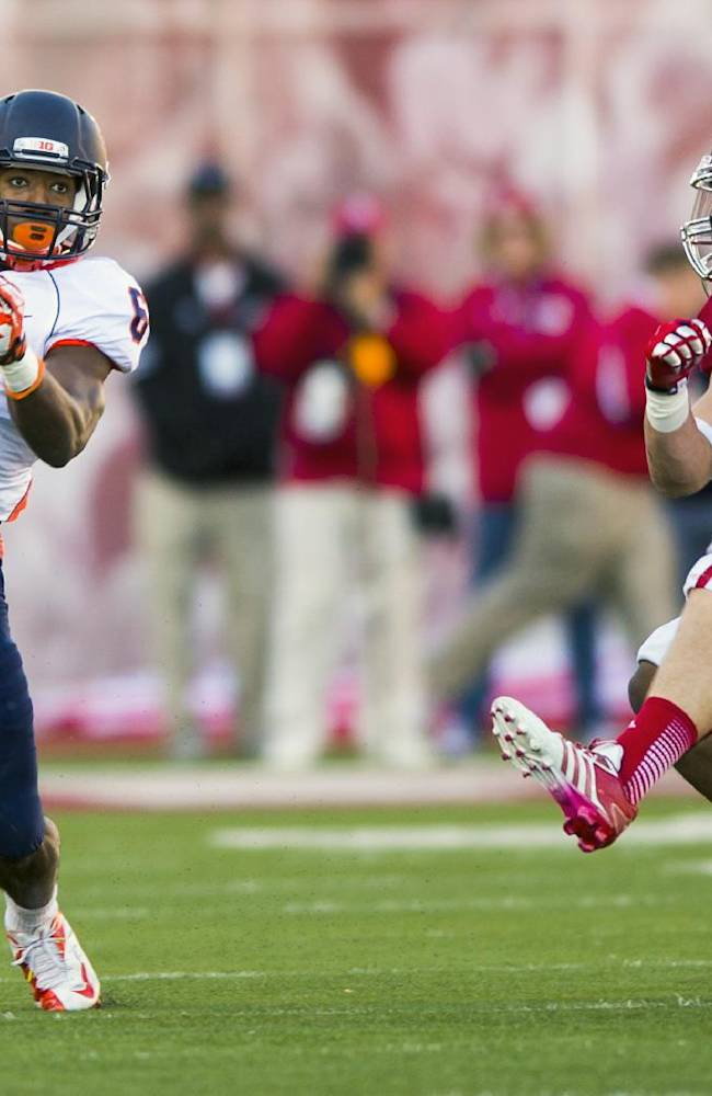 Illinois' Josh Ferguson (6) makes a move toward the sideline and away from Indiana's Greg Heban (9) during the first half of an NCAA college football game, Saturday, Nov. 9, 2013, in Bloomington, Ind