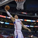 Los Angeles Clippers forward Blake Griffin goes up for a shot as Houston Rockets forward Patrick Patterson watches during the first half of their NBA basketball game, Wednesday, Feb. 13, 2013, in Los Angeles. (AP Photo/Mark J. Terrill)