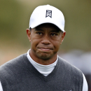 Tiger Woods grimaces after finishing the ninth hole during the second round of the Phoenix Open golf tournament, Friday, Jan. 30, 2015, in Scottsdale, Ariz. (AP Photo/Rick Scuteri)