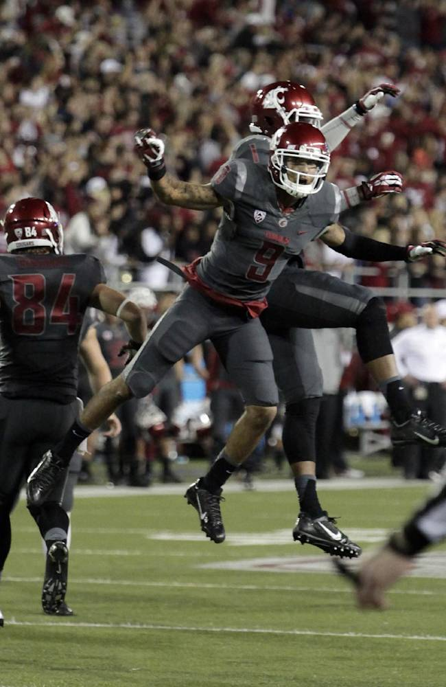 Washington State wide receiver Gabe Marks (9) celebrates with wide receiver Vince Mayle, obscured, after Marks caught a touchdown pass late in the second quarter during an NCAA college football game against Idaho on Saturday, Sept. 21, 2013, in Pullman, Wash