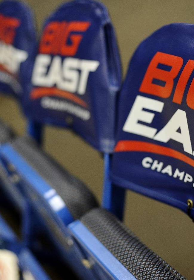 The logo for the Big East Conference is displayed on a row of team chairs at the Big East Conference women's basketball tournament in Hartford, Conn., Friday, March 8, 2013. The Big East has reached an agreement with seven departing basketball members that will allow them to separate from the football schools and create their own conference on July 1. Commissioner Mike Aresco told The Associated Press on Friday the seven Catholic schools that are leaving to form a basketball-centric conference will get the Big East name, along with the opportunity to play their league tournament in Madison Square Garden