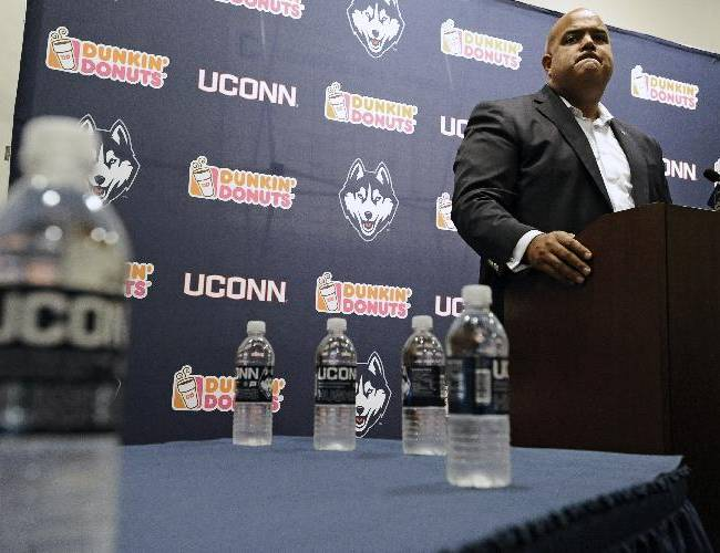 Connecticut Athletic Director Warde Manuel speaks at an NCAA college football news conference after the dismissal of Connecticut football coach Paul Pasqualoni, Monday, Sept. 30, 2013, in Storrs, Conn. Offensive coordinator T.J. Weist will take over as interim head coach