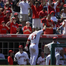 Trout has grand slam, solo HR in Angels' win over Rangers The Associated Press