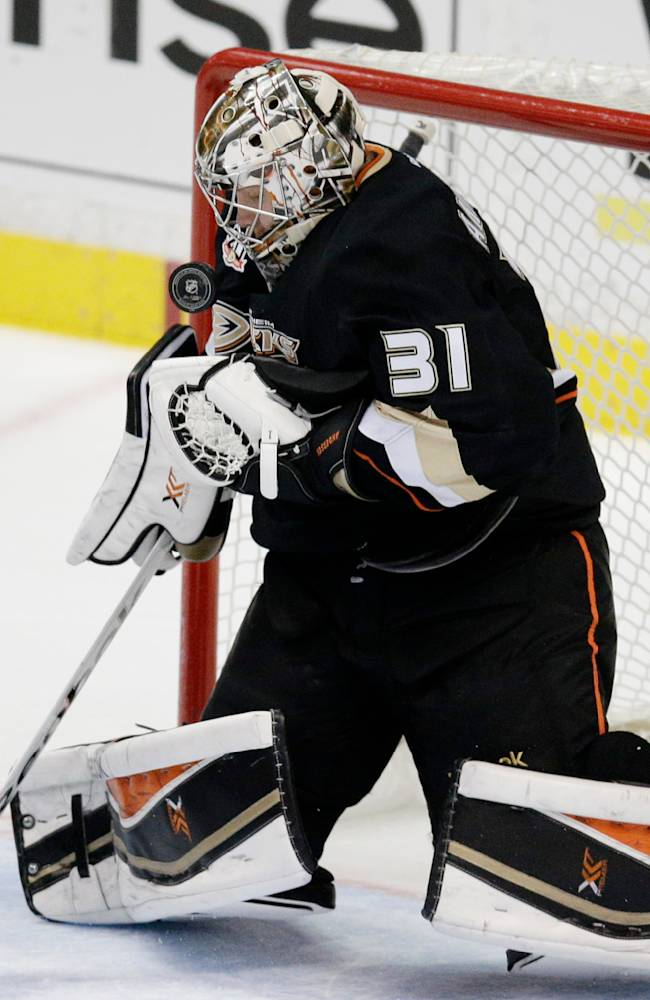 Anaheim Ducks goalie Frederik Andersen, of Denmark, stops a shot during the second period of an NHL hockey game against the Vancouver Canucks on Wednesday, Jan. 15, 2014, in Anaheim, Calif