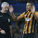 Hull's Jake Livermore puts his hands up as he disputes a call by referee Chris Foy during their English Premier League soccer match between Chelsea and Hull City at Stamford Bridge stadium in London, Saturday, Dec. 13, 2014