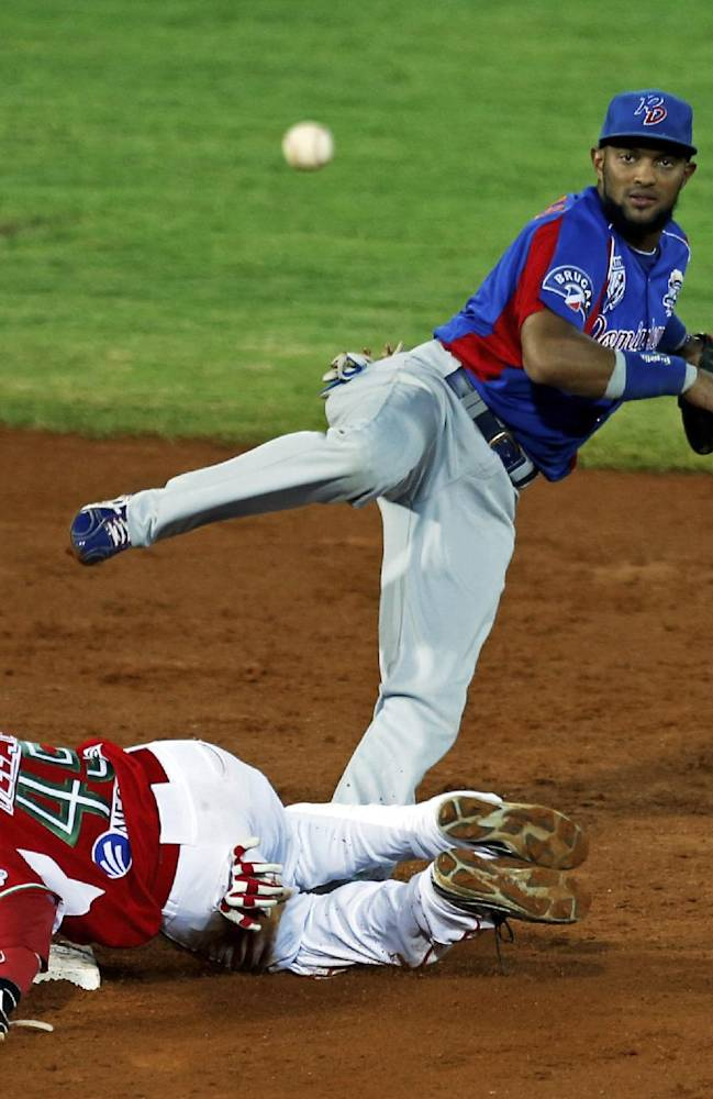 Dominican Republic's Emilio Bonifacio, top, releases the ball to first base after tagging out Mexico outfielder Chris Roberson at second base, completing a double, during a Caribbean Series baseball semifinal game in Porlamar, Venezuela, Thursday, Feb. 6, 2014