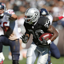 Oakland Raiders running back Darren McFadden, right, carries the ball for a touchdown on a 1-yard run as Houston Texans inside linebacker Brian Cushing, left, pursues in the fourth quarter of an NFL football game Sunday, Sept. 14, 2014, in Oakland, Calif.