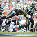 Seattle Seahawks' Marshawn Lynch flies into the end zone for a touchdown in overtime against the Denver Broncos in an NFL football game Sunday, Sept. 21, 2014, in Seattle. The Seahawks defeated the Broncos 26-20 The Associated Press