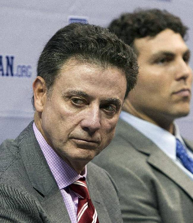 Louisville coach Rick Pitino, left, and Memphis coach Josh Pastner attend the American Athletic Conference NCAA college basketball media day on Wednesday, Oct. 16, 2013, in Memphis, Tenn