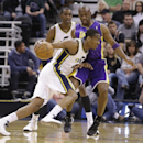 Utah Jazz's Alec Burks (10) drives around Los Angeles Lakers Jodie Meeks, rear, in the first quarter during an NBA basketball game Monday, April 14, 2014, in Salt Lake City, Utah The Associated Press