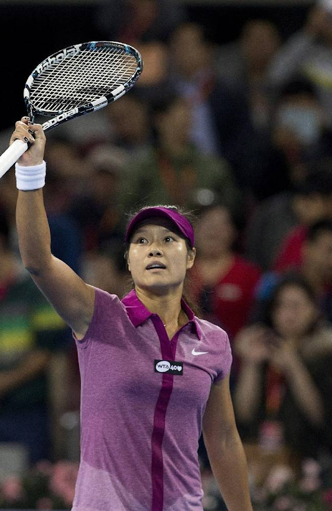 Li Na of China acknowledges the crowd after defeating Sabine Lisicki of Germany during the China Open tennis tournament at the National Tennis Stadium in Beijing, China Wednesday, Oct. 2, 2013