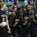 Wichita State players from left, Ron Baker, Ehimen Orukpe, Nick Wiggins and Chadrack Lufile, celebrate on the sideline during the second half of a second-round game in the NCAA college basketball tournament against Pittsburgh Thursday, March 21, 2013, in Salt Lake City Wichita State won 73-55. (AP Photo/George Frey)