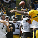Pittsburgh Steelers quarterback Ben Roethlisberger (7) tries to pass over defensive lineman Daniel McCullers (74) during NFL football training camp in Latrobe, Pa., on Wednesday, July 30, 2014 The Associated Press