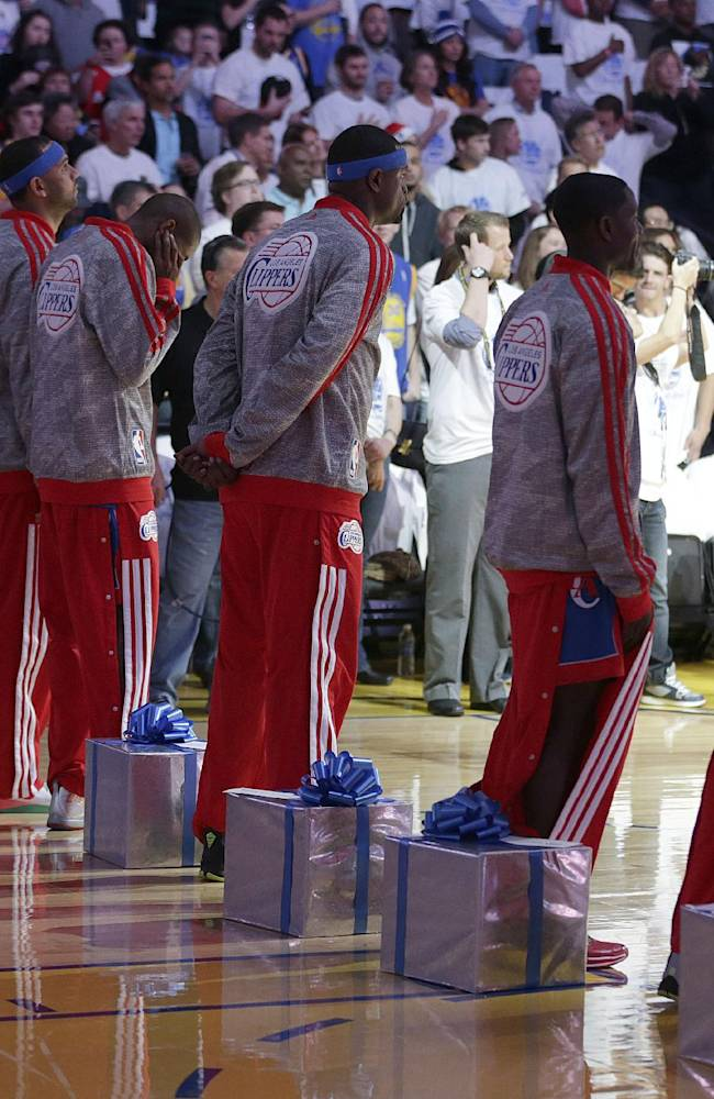 Los Angeles Clippers players take part in a Christmas gift exchange with young children before the Clippers' NBA basketball game against the Golden State Warriors, Wednesday, Dec. 25, 2013, in Oakland, Calif
