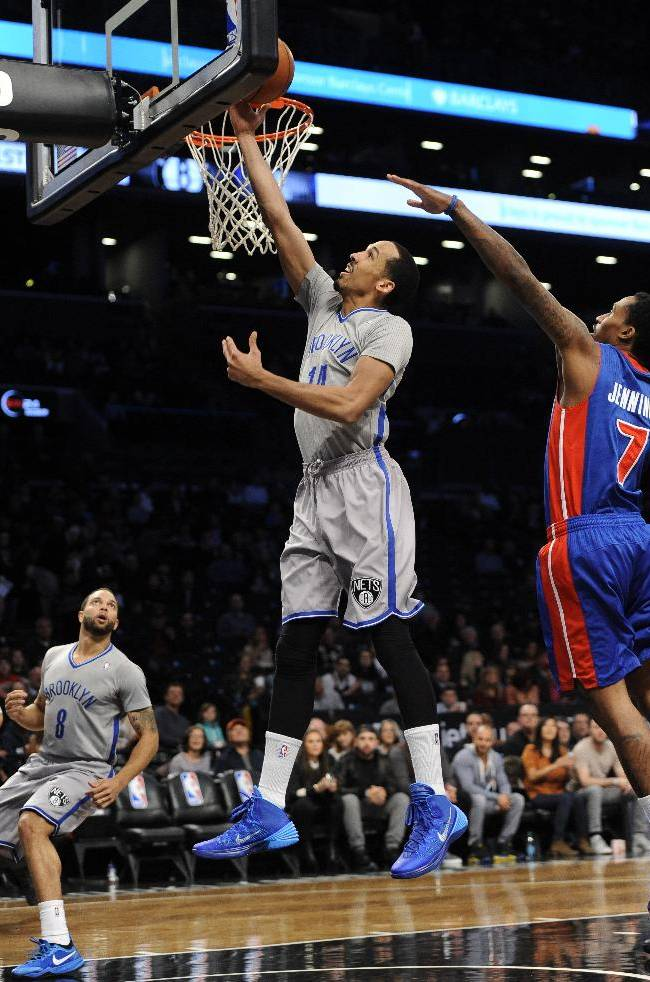 Brooklyn Nets' Deron Williams (8) watches as Shaun Livingston (14) drives the ball to the basket ahead of Detroit Pistons' Brandon Jennings (7) during the first half of an NBA basketball game Friday, April 4, 2014, in New York