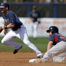 Boston Red Sox Mike McCoy reaches second base on a ground out by Jackie Bradley Jr. as Tampa Bay Rays second baseman Ben Zobrist covers in the ninth inning of an exhibition baseball game in Port Charlotte, Fla., Tuesday, March 25, 2014. The Red Sox won 4