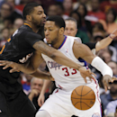 Phoenix Suns forward Marcus Morris, left, reaches in to steal the ball away from Los Angeles Clippers forward Danny Granger (33) during the second half of an NBA basketball game Monday, March 10, 2014, in Los Angeles. Clippers won 112-105 The Associated P